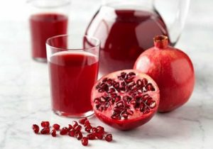 does pomegranate juice lower cholesterol